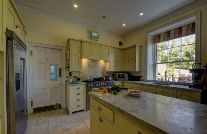 Ground Floor: Modern, stylish and spacious kitchen fully equipped and with large Range cooker