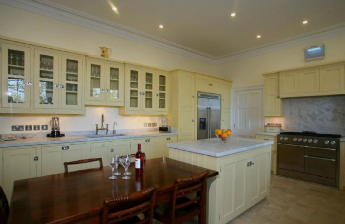 Ground Floor: Open plan, modern fully equipped kitchen with island unit