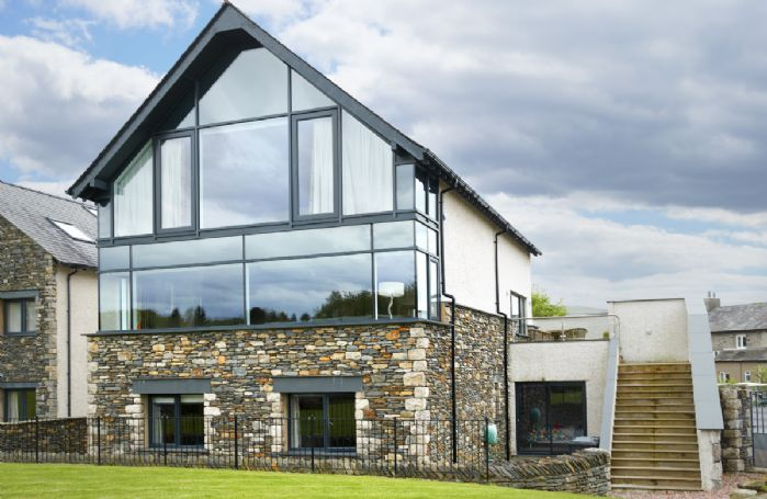 Carus House is a stunning property with views of Carus Green Golf Club and the Lakeland fells beyond