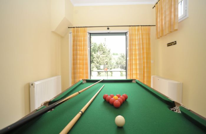 Ground floor: Games room, with snooker table and board games, leading out onto the terrace with barbecue and table tennis table