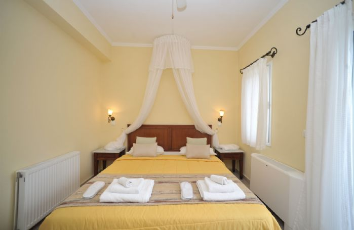 First floor: Double bedroom with queen size bed and en-suite bathroom