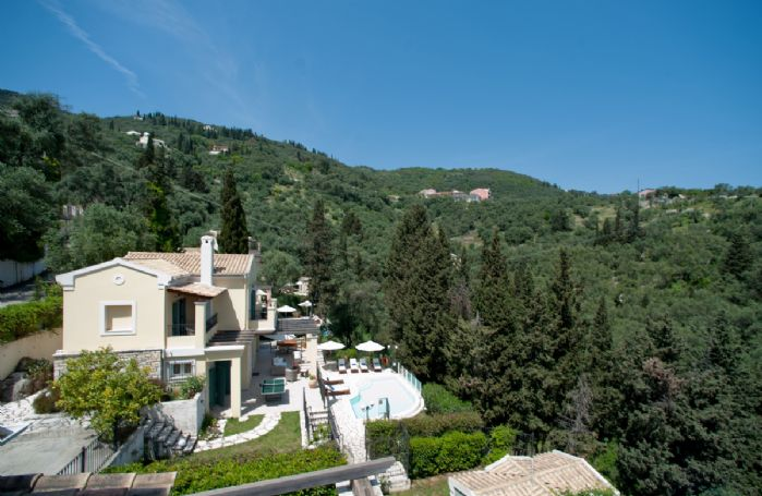 Nestling on a steep hillside amongst the olive groves, Villa Lemonia boasts lovely views from the upper terrace, looking out over the trees and down to the sea beyond