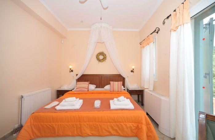 First floor: Double bedroom with queen size bed and en-suite bathroom