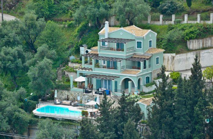 Villia Elia nestled in a hillside location among olive groves