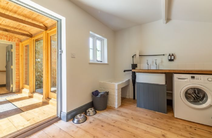 Ground floor: Utility room leading to outside space