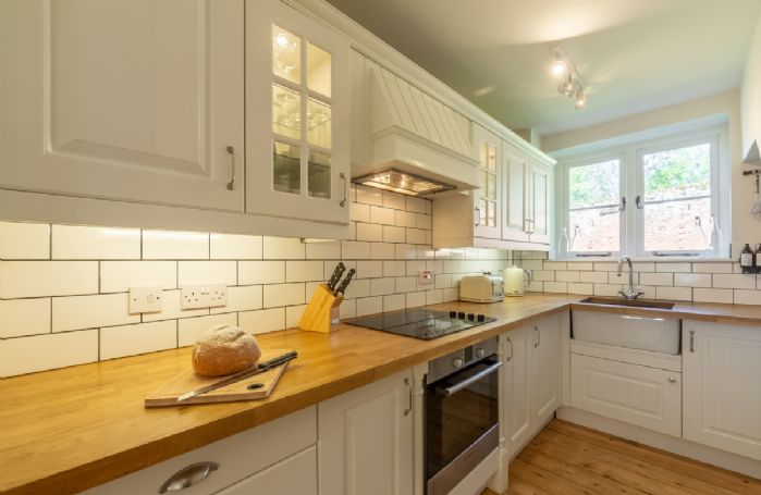 Ground floor: Shaker style kitchen with wooden worktops and belfast sink