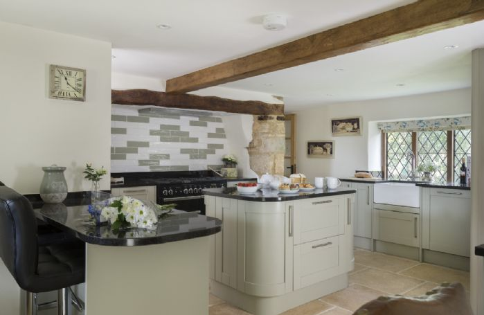 Ground floor: Kitchen with island and breakfast bar allowing for sociable cooking and entertaining