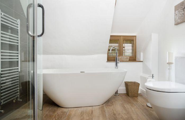 First floor: Family bathroom with deep bath  tub and walk in shower