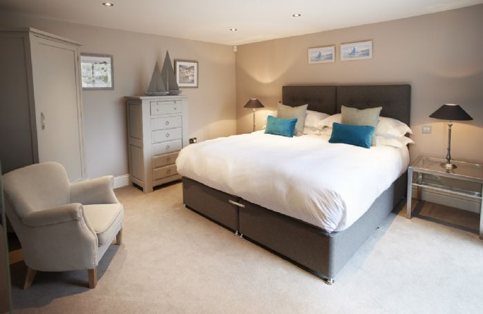 Ground floor: Bedroom One with 6' super king zip/link bed and en-suite shower room
