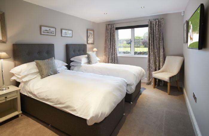 Ground floor: Bedroom Two with 6' super king zip/link bed and en-suite shower room
