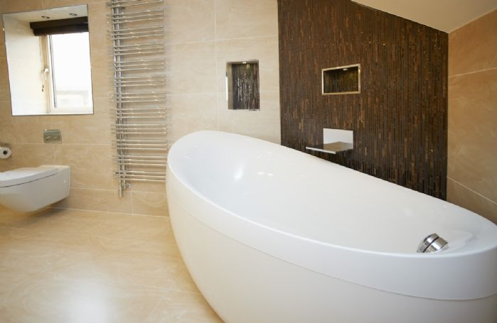 Second floor: En-suite bathroom with waterfall shower, his & hers sinks, spa bath and built-in wall TV