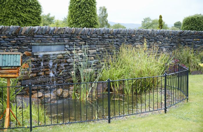 Large landscaped garden with water feature
