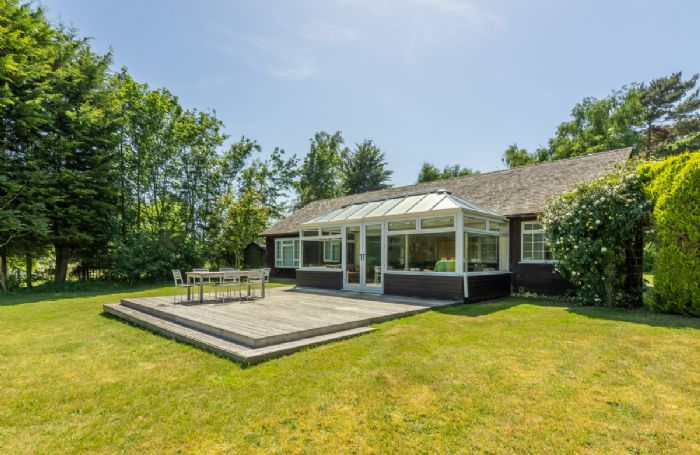 Large sundeck with a well established, enclosed garden