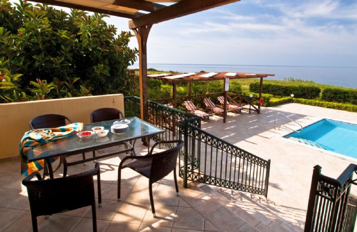 Terrace with sea views and steps down to the pool