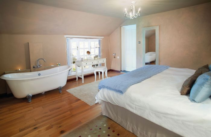 Ground floor: Double bedroom with 6'6 bed and freestanding roll top bath