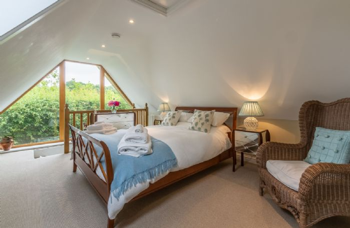 First floor: Bedroom with 5' bed.  In order to benefit from the stunning floor to ceiling window there are no curtains,  however eye masks are provided to ensure a good nights sleep during the summer months
