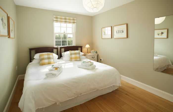 Ground floor: Small twin bedroom with 3' beds which can be converted to a 6' bed on request