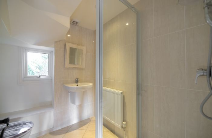 First floor: Spacious en suite shower room