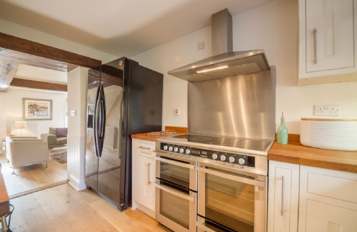 First floor:  Fully fitted kitchen with range cooker