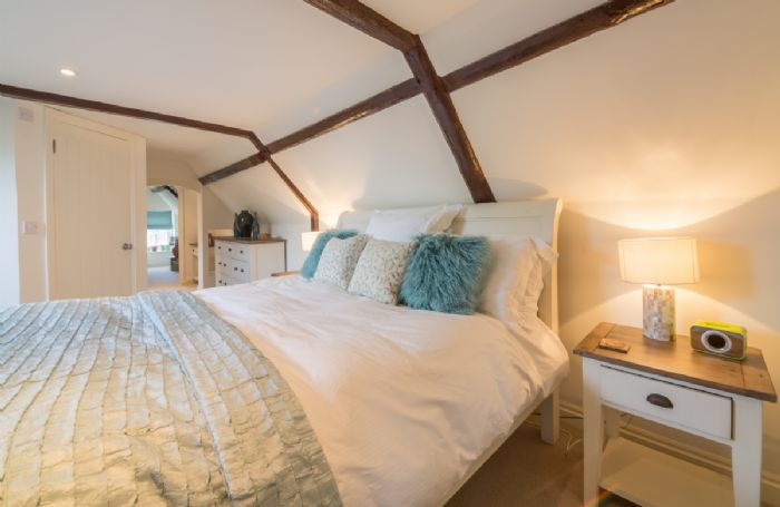 First floor:  Bedroom three  with exposed beams