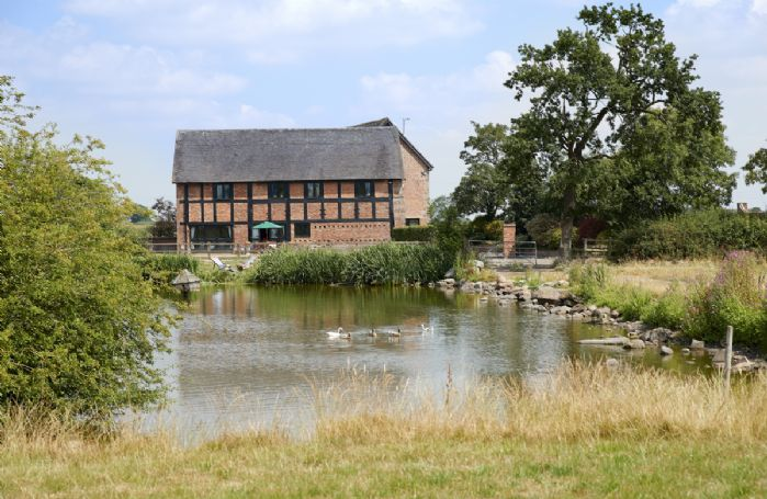Enjoy a picnic by the pond at The Old Cart House