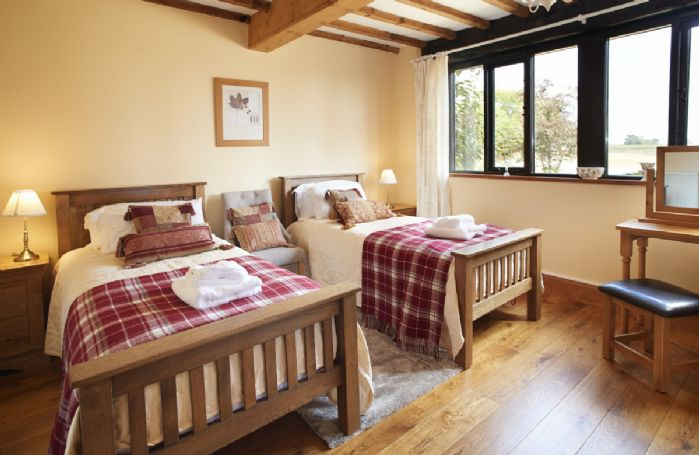 Ground floor: Twin beds with views across the garden.