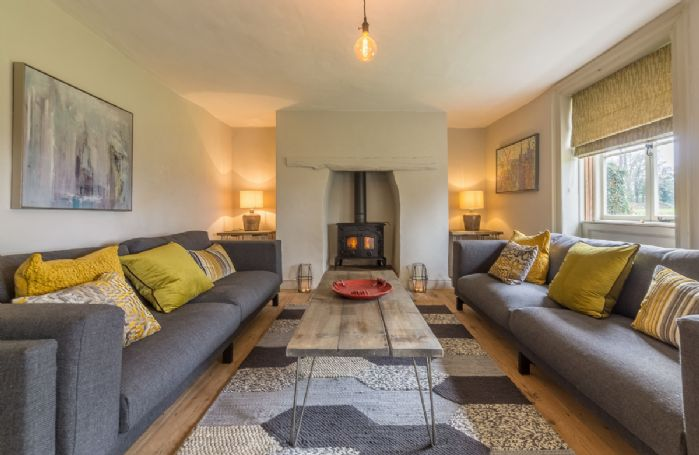 Ground floor:  Sitting room, light the wood burning stove and relax on the sofas