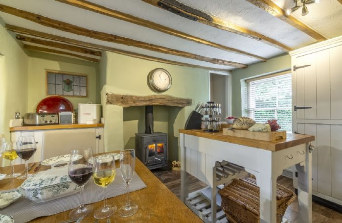 Ground floor: Large kitchen/dining room with wood burning stove