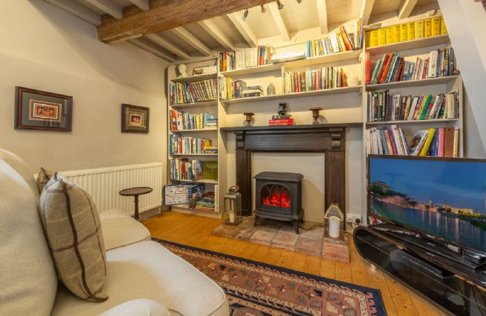 Ground floor: Large entrance hall with library/snug area