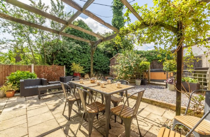 Private enclosed garden and patio with hot tub