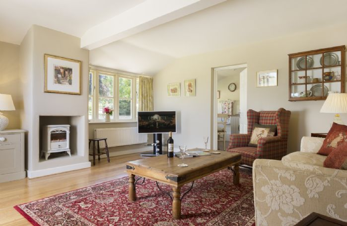 Ground floor: Light and airy sitting room with windows facing the gardens
