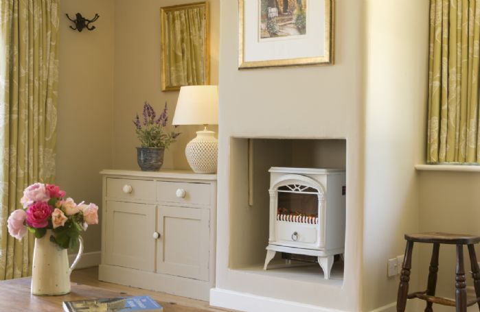 Ground floor: Electric wood effect stove