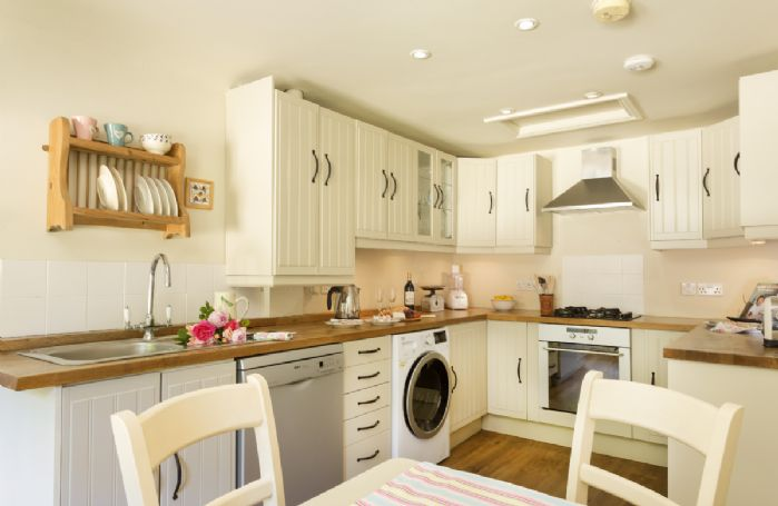 Ground floor: Fully equipped fitted kitchen with dining table