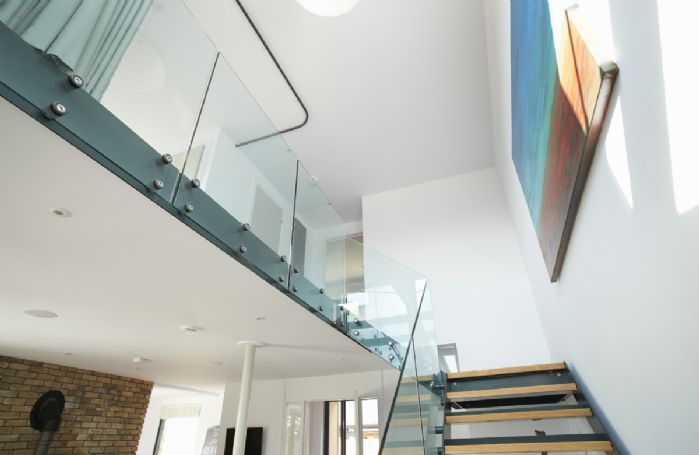 Industrial style stairs leading to bedroom two