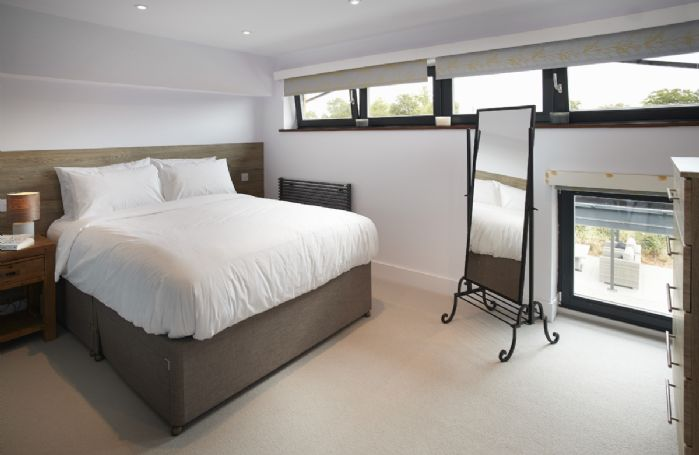 First floor:  Second bedroom with king size bed