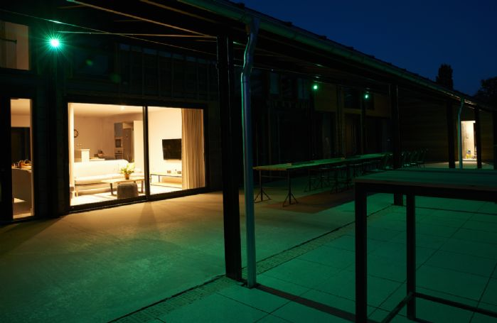 The exterior of Barn 2 at night