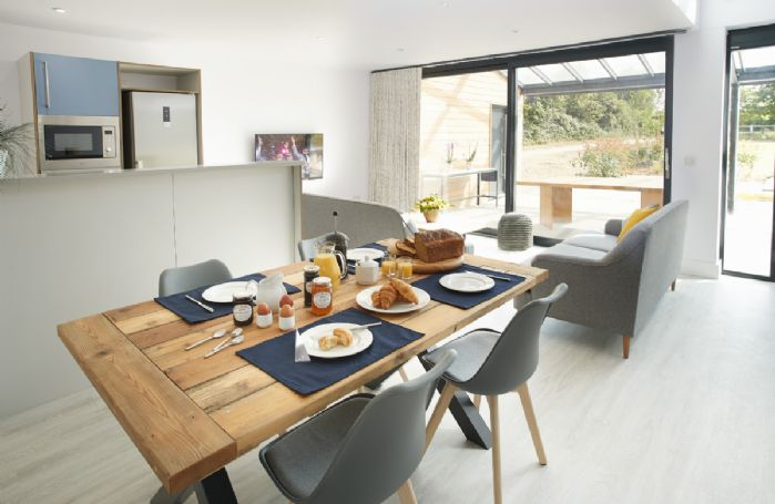 Ground floor: Open plan with doors leading to outside space