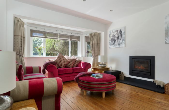 Ground floor:  Cosy snug with wood burning stove and wooden flooring.