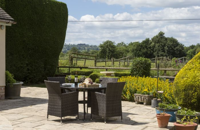 Open the doors from the living area onto this terrace which is the perfect spot to enjoy your barbecue.