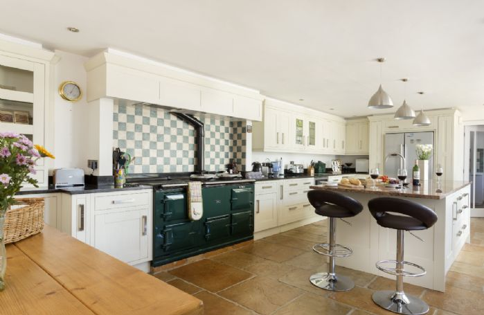 Ground floor: Large Aga in fully equipped modern kitchen/dining area.