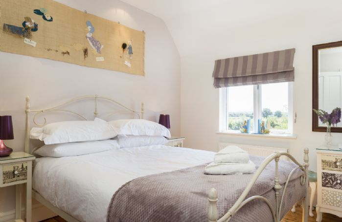First Floor: Double bed with views to the garden