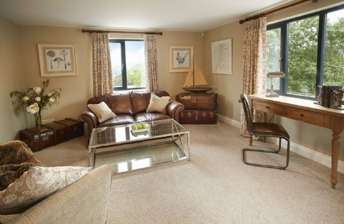 Ground floor: Study/reception room with dual aspect views up and across Lake Windermere