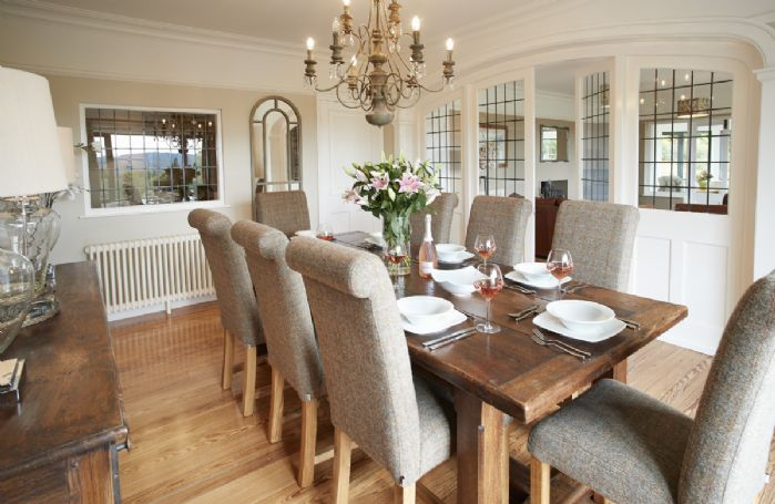 Ground floor: Dining room with table seating ten and large picture window with window seat and views across the Lake