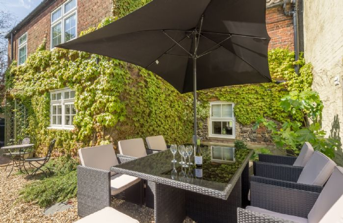 Rear garden with terrace and garden furniture