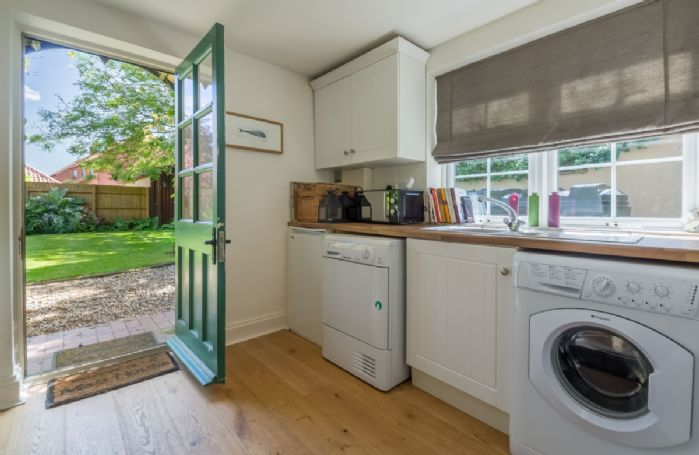 Ground floor: Utility room leading to garden