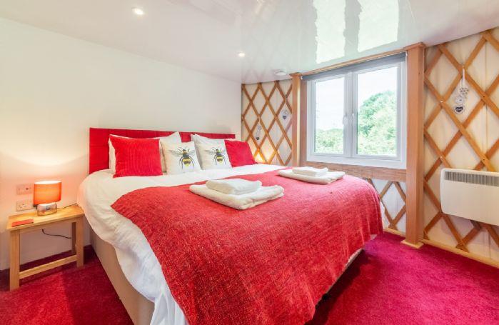 Ground floor: Bedroom with 6' super-king bed