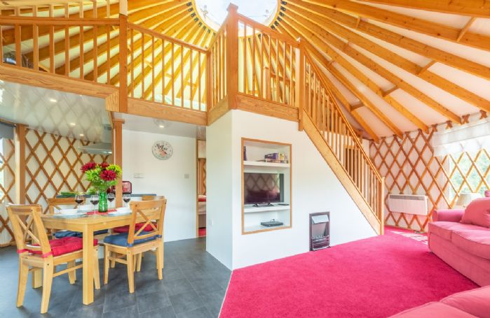 Ground floor: Spacious, light living area combined with Douglas fir rafters and lattice work