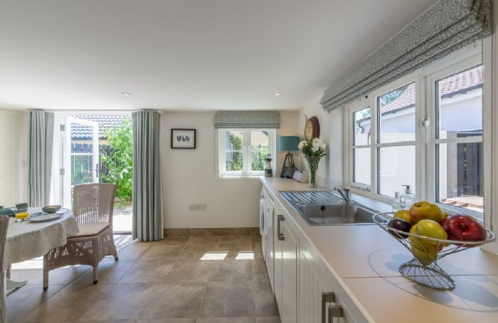 Ground floor:  Spacious kitchen with french doors opening to outside