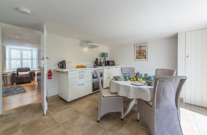 Ground floor:  Kitchen leading to sitting room