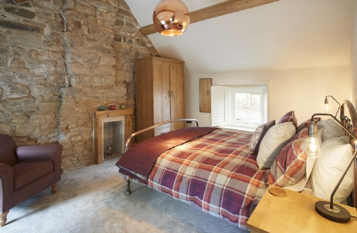 First floor: Bedroom with king size bed and en-suite shower room